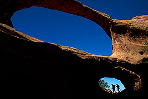 People silhouettes in Arches National Park