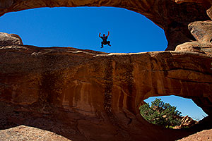 Frog jumping at Double O Arch in Arches National Park