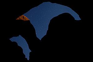 Moonlit rocks and sky of Double Arch in Arches National Park