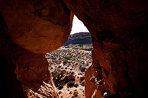 View of the road through a window in Arches National Park