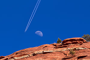 Plane flying near the moon and making tracks in Sedona