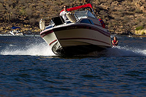 Boat and wakeboarder at Canyon Lake in Superstitions