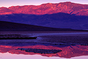 Badwater morning mountain reflection in Death Valley