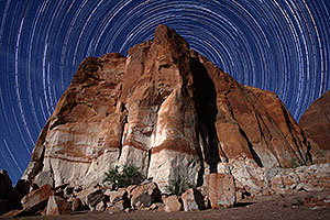 3.5 hours of star trails above a rock at Lake Powell