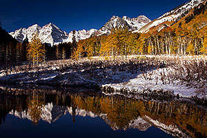 Snowy Pond reflection of Maroon Bells, Colorado