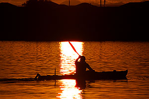 Kayaker at sunset at Tempe Town Lake
