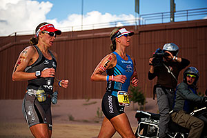 06:31:01 - #72 Meredith Kessler [USA] (eventual 4th) and #73 Amanda Stevens [USA] (eventual 5th, 9 minutes later) in Lap 1 - Ironman Arizona 2011