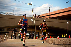 06:45:04 - #34 Paul Amey [USA] (on the right) in the lead (eventually 2nd) in Lap 2, ahead by a lap of #29 Douglas MacLean [USA] (eventually 34th) - Ironman Arizona 2011