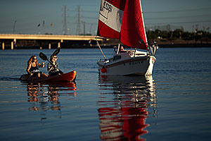 Kayakers and sailboat at Tempe Town Lake