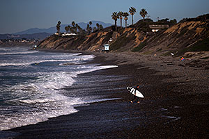 Surfers by Carlsbad, California