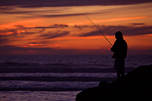 Fishing at sunset by Carlsbad, California