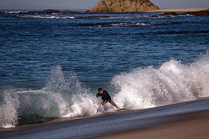 Skimboarders at Aliso Beach, California
