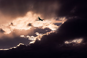 Plane and angry sky clouds
