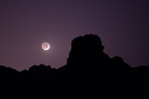 Mountain silhouettes and crescent moon in Superstitions