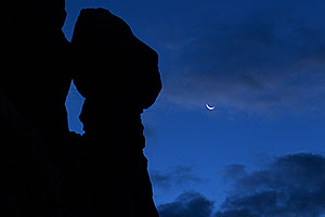 Crescent Moon in Arches National Park before sunrise