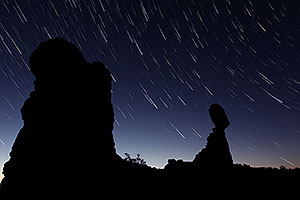 22 minutes of star trails at Balanced Rock in Arches National Park at sunrise