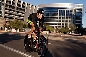 00:57:55 #17 Patrick Bless [19th,GER,09:21:22] cycling at Ironman Arizona 2014