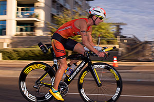 01:00:45 #70 Meredith Kessler [1st,USA,08:44:00] cycling at Ironman Arizona 2015