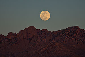 Moon rising by Santa Rita Mountains in Arizona