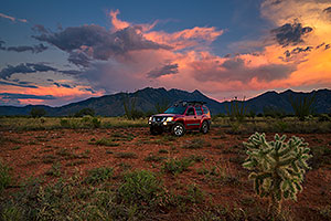 Xterra at sunset by Santa Rita Mountains