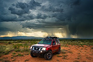Xterra with lightning and monsoon clouds in Santa Rita Mountains
