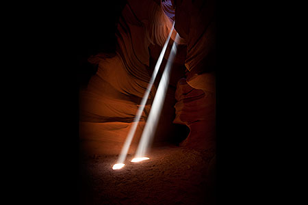 Sun beaming into a slot canyon in Utah