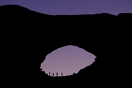 People silhouettes in Double Arch in Utah
