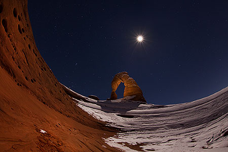 Moon over Delicate Arch in Utah