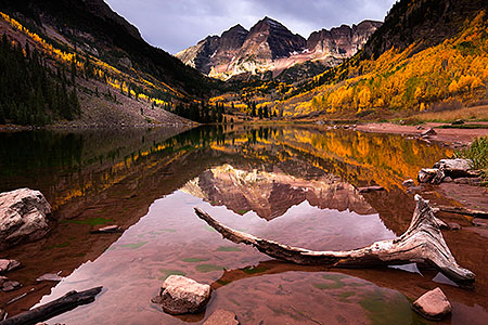 Fall reflection of Maroon Bells in Colorado