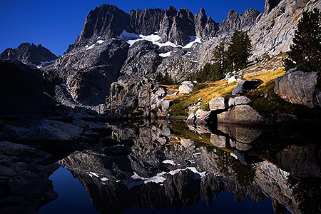 Minarets reflecting in Iceberg Lake in Eastern Sierra, California