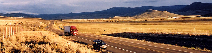 /images/500/2004-10-yaks-landscape-sp.jpg - #02370: red semi truck heading to Gunnison in the late October afternoon … Yaks to the right  … October 2004 -- Sargeants, Colorado