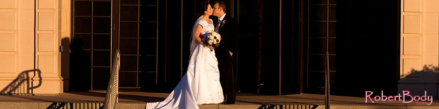 /images/500/2008-12-27-mesa-temple-brides-68100sp.jpg - #06620: Bride and Groom kissing at Mesa Arizona Temple … December 2008 -- Mesa Arizona Temple, Mesa, Arizona